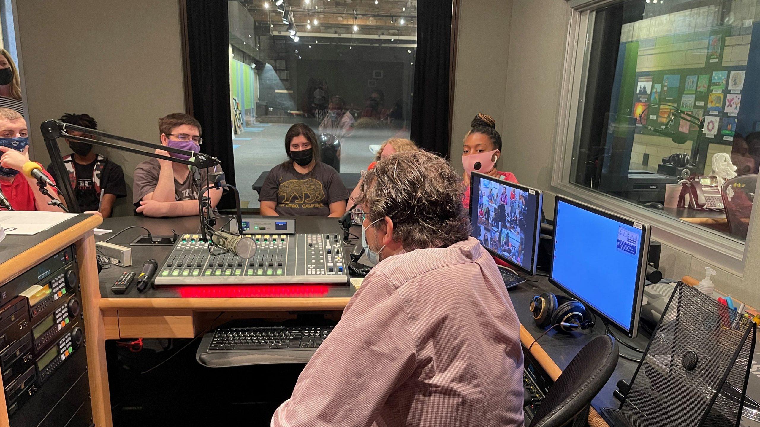 Readiness Institute summer camp participants visit the set of the Saturday Light Brigade Radio